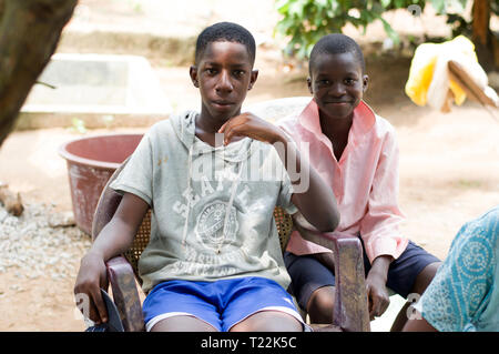 Abidjan, côte d'ivoire - February 22, 2017: two African children sitting side by side are happy to pose with the photographer - Stock Image