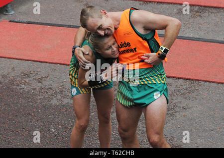 London, UK, 28 April 2019 Louzanne Coetzee of RSA. Runners at finishing line of  Virgin London Marathon Credit: JOHNNY ARMSTEAD/Alamy Live News - Stock Image