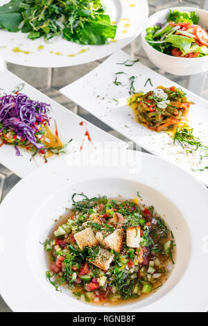 mixed portuguese traditional tapas snacks and salads selection on lisbon restaurant table - Stock Image