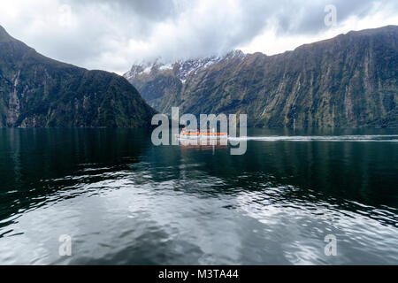 Tourist boat on Milford Sound - Stock Image