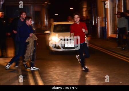 Aberystwyth Wales UK, New Year's Celebrations Dec 31  2018 - January 01 2019  People out on the streets celebrating the start of the new year 2019 in Aberystwyth on the west coast of Wales   photo © Keith Morris / Alamy Live News - Stock Image