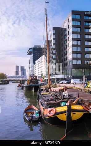 Leuvehaven harbour, where boat exhibits from the Maritime Museum and modern Dutch architecture can be seen together, - Stock Image