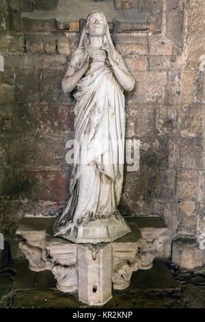 Statue of the Virgin in the Cloisters of the Lisbon Cathedral - Stock Image