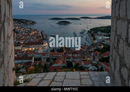 Elevated view over Hvar Town from the Spanish Fortress at dusk, Hvar, Croatia, Europe - Stock Image