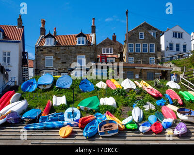 Small pleasure craft on the slipway in front of the village of Runswick Bay North Yorkshire England - Stock Image