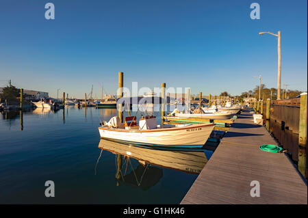 Millway Marina, Barnstable, Cape Cod, Massachusetts in the fall autumn with wooden boats, clear blue sky, copy space. - Stock Image
