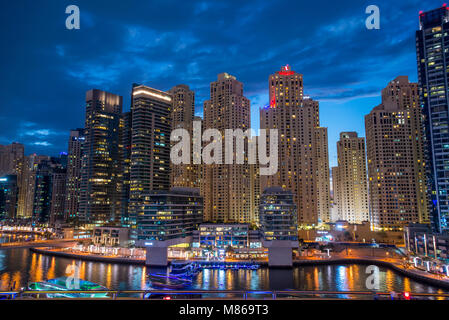 Cityscapes by day and night, featuring Singapore or Dubai.  For Singapore, featuring Marina Bay Sands by the Harbour. - Stock Image