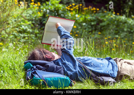 The reader reads a book in the park, Czech Republic - Stock Image
