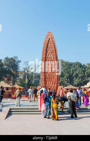Flame monument at Jallianwala Bagh, a public garden in Amritsar, Punjab, India, a memorial commemorating the 1919 British Jallianwala Bagh Massacre shooting - Stock Image