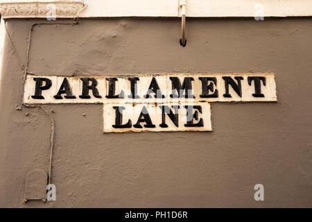 Gibraltar, Main Street, Parliament Lane, old ceramic street sign - Stock Image