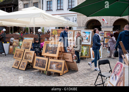 Paintings display at the bazaar in Kazimierz Dolny, Poland, Europe, bohemian tourist travel destination, sightseeing - Stock Image