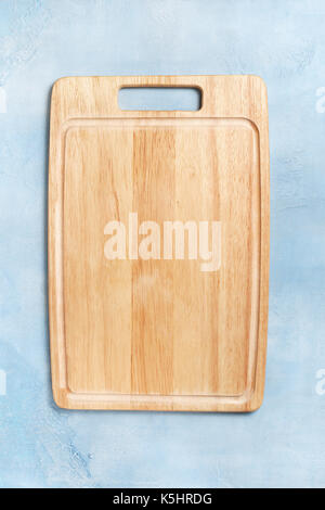 cutting board on a blue concrete background. view from above.  copy space - Stock Image