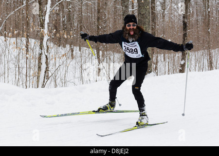 A man reacts to a photographer while skiing in the American Birkebeiner on the trail between Cable and Hayward, - Stock Image