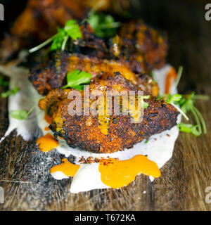 Chicken wings served in Charleston, South Carolina, USA. The chicken has been marinaded prior to cooking. - Stock Image