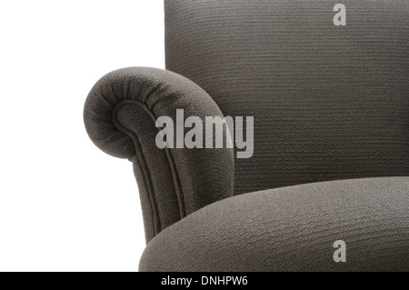 A section of a comfortable grey sofa couch furniture. - Stock Image
