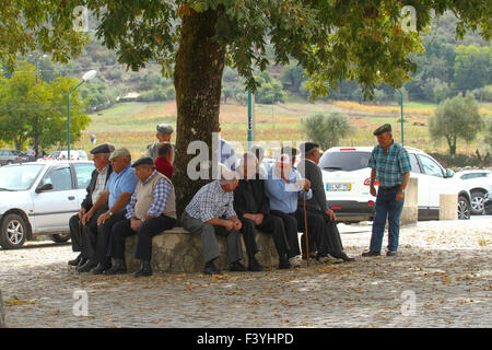 Arrimal, Portugal, 2 October, 2015.  Elderly men chat outside the church at Arrimal during a Saturday mass. Tour - Stock Image