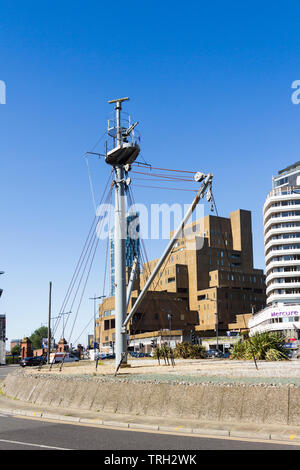 Forward mast and derricks of former salvage ship and buoyage tender, SS Salvor, on the traffic island/roundabout at the junction of St Nicholas Place - Stock Image