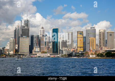 Sydney Cityscape across the harbour with high rise office buildings and skyscrapers in the city centre,New South Wales,Australia - Stock Image