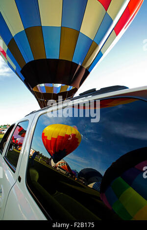 Reflection of hot air balloons in a chase vehicle's windows at the Atlantic International Balloon Fiesta, Sussex, - Stock Image