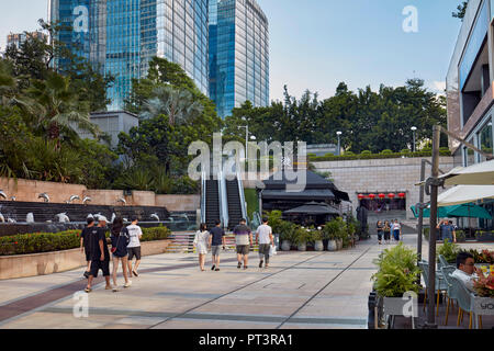 People walking in the courtyard of Wongtee Shopping Plaza. Shenzhen, Guangdong Province, China. - Stock Image
