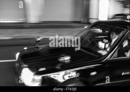 A Tokyo taxi and its driver in Akasaka - Stock Image