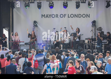 London,UK,20th April 2019,The Rin Tins perform on stage as People enjoy The Feast of St George which took place in Trafalgar Square, London. Glorious sunshine added to the English Country Garden feel. The main stage featured a mix of traditional and contemporary acts compered by Lydia Bright. People enjoyed traditional dishes from the English Food Market along with an artisan craft market. There was also a family zone with a knights training camp, Face painting and even a dragon's nest. Credit: Keith Larby/Alamy Live News - Stock Image