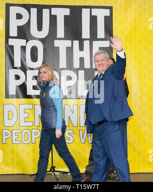 London, UK. 23rd Mar, 2019. Justine Greening MP and Ian Blackford MP SNP leader leaving the stage at the People's Vote March and rally, 'Put it to the People.' Credit: Prixpics/Alamy Live News - Stock Image