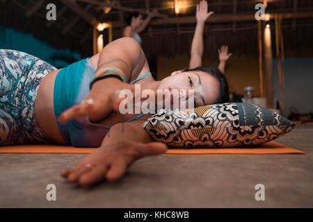 People meditating and practicing yoga. Yoga retreat Puerto Vallarta - Mismaloya, Mexico - Stock Image