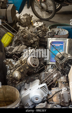 A pile of removed and dismantled motorcycle engines in mechanics workshop. - Stock Image