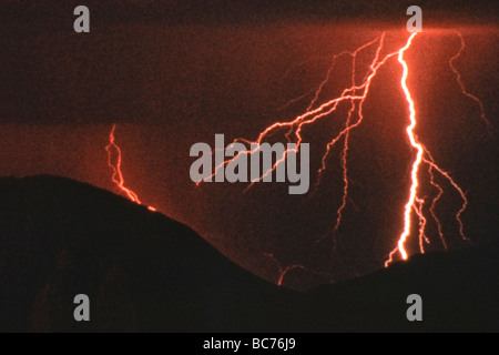 night lightning strike in mountains - Stock Image