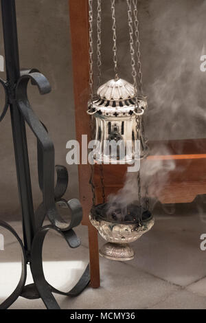 Tenerife, Canary Islands, an incense burner during the Palm Sunday Holy Week service  in the Cathedral of San Cristobal de La Laguna. - Stock Image