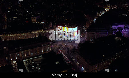 London, UK - October 2018: Aerial view at night of the Piccadilly Circus square international tourist destination feat. Piccadilly Lights, UK - Stock Image