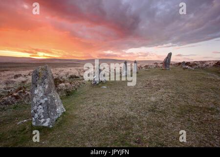 Sunset at Scorhill stone circle Dartmoor national park Devon Uk - Stock Image