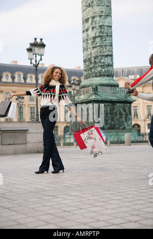 Tourist with shopping bags, Paris, France - Stock Image