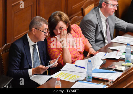 Prague, Czech Republic. 26th June, 2019. L-R Czech Prime Minister Andrej Babis, Finance Minister Alena Schillerova and Industry and Trade Minister Karel Havlicek attend the Chamber of Deputies meeting to hold no-confidence vote in Babis's government, triggered by five opposition parties, in Prague, Czech Republic, on June 26, 2019. Credit: Vit Simanek/CTK Photo/Alamy Live News - Stock Image