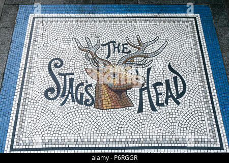 The Stag's Head pub entrance mosaic from the perfectly preserved traditional Victorian Pub of the same name, Dame Street, Dublin, Ireland, Europe. - Stock Image