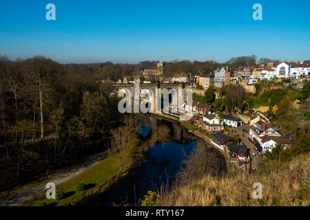 Town of Knaresborough Yorkshire with a view over the River Nidd, and the railway viaduct on a bright early spring morning - Stock Image