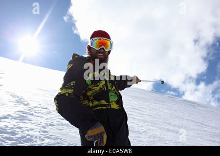 Mid adult man skier pointing at mountain, Mayrhofen, Tyrol, Austria - Stock Image