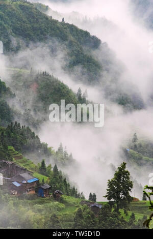 Village in the mountain in morning mist, Jiabang, Guizhou Province, China - Stock Image