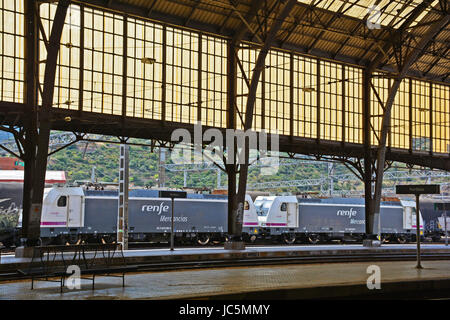 truck of Renfe Mercancias company in Portbou railway station, Spain - Stock Image