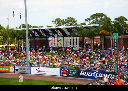 Fans sitting on the berm at a spring training baseball game at Tradition Field, Port St. Lucie, FL, USA - Stock Image