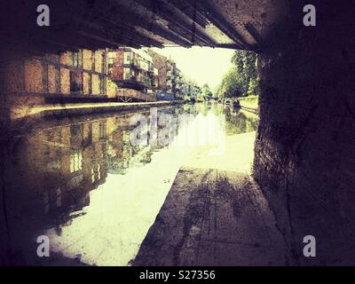 Grainy photo of Hertford Union canal from under a bridge in bow, East London - Stock Image