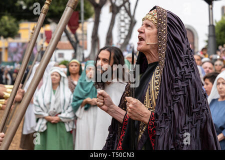 Adeje, Tenerife, Canary Islands. 19 April 2018. Hundreds take part in Good Friday presentation of Adeje's dramatisation of the Good Friday events leading up the crucifixion of Jesus Christ has been deemed a success for another year. The Calle Grande in Adeje was taken over by the dramatisation, 'La Pasión' today, with hundreds of local people taking part in the annual event depicting the last days and crucifixion of Jesus Christ.  The streets were also full of visitors who followed the action, and the events were broadcast life on television and social media. - Stock Image