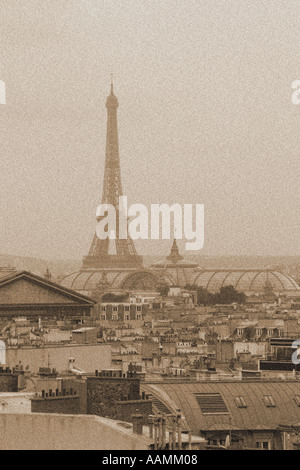 Sepia portrait shot of Eiffel Tower across rooftops of Paris France - Stock Image