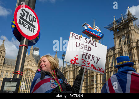 Protestors demonstrate their distaste for the UK government's handling of Brexit negotiations - and specifically, the failed business deal to contract the Seabourne Ferry contract from Ramsgate - during a pro-EU brexit protest opposite Parliament, on 11th March 2019, in Westminster, London, England. - Stock Image