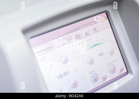 Machine touchscreen of laser machine in clinic, close-up. - Stock Image