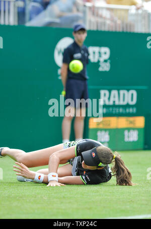 Eastbourne, UK. 25th June, 2019. Johanna Konta of Great Britain slips over during her win over Maria Sakkari of Greece during their second round match the Nature Valley International tennis tournament held at Devonshire Park in Eastbourne . Credit: Simon Dack/Alamy Live News - Stock Image
