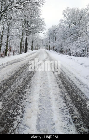 Dangerous street with ice and snow - Stock Image