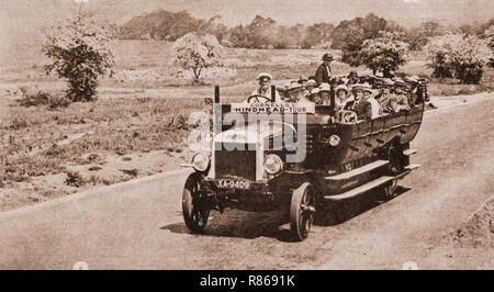 Following the end of rthe hostilities of World War One, the open charabanc became a popular form of transport. - Stock Image