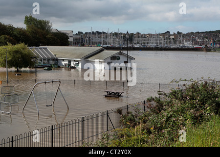 Local Dorset restarant The Gurkin and kids play area underwater after heavy rainfall in Wemymouth - Stock Image